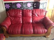 red leather SOFA AND TWO CHAIRS